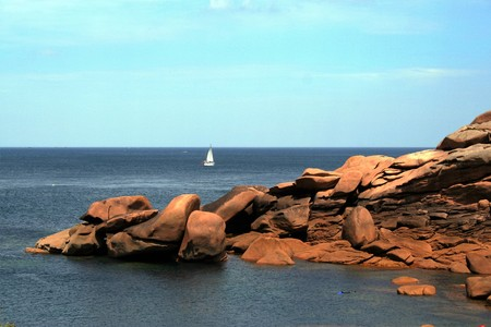 ploumanach: the amazing rocks of pink granite coast in Brittany and suggestive Ploumanach lighthouse Stock Photo