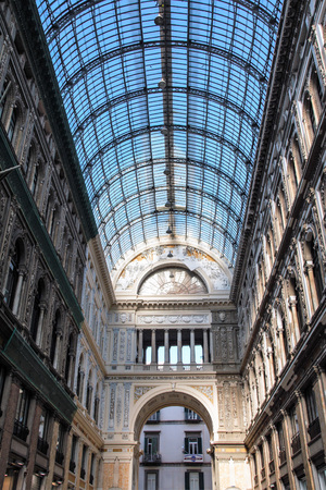 iron and glass ceiling and  art nouveau decorations in the gallery Umberto in Naples
