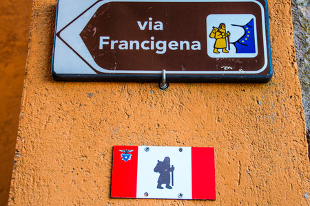 arrow sign of Via Francigena, ancient pilgrimage route through italy and france