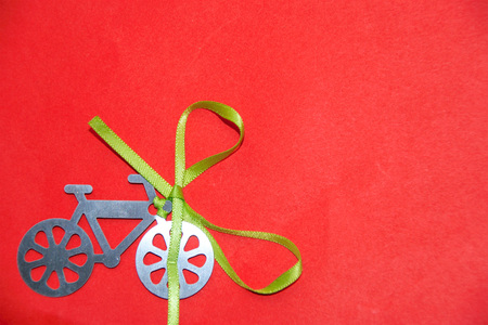bycicle silhouette with a green ribbon on a red background