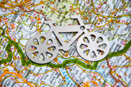 geographic: bycicle silhouette on the background of a geographic  map