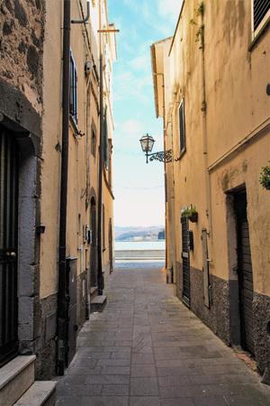 picturesque streets of the fishermen burg of Marta on Bolsena lake, Lazio, Italy, Stock Photo