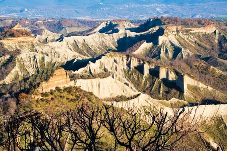landscape of calanchi valley at civita bagnoregio and its harsh chalky cliffs, Viterbo,  Lazio, Italy,  Stock Photo