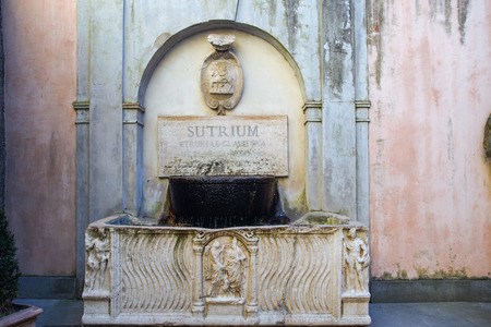 lazio: Old sculpted fountain in Sutri, Lazio, Italy