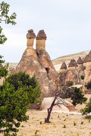cavern: spectacular rock formations called fairy chimneys in the valley of Goreme, Cappadocia, Turkey