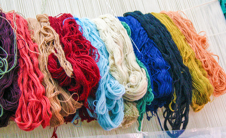 wool bundles on a loom for hand made carpets, Turkey Stock Photo