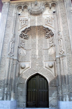The highly ornamented stone façade of the entrance of the Ince Minareli Medrese  in Konya , Cappadocia, Turkey
