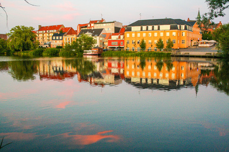 danish: colorful houses of of Hillerod reflecting in lake