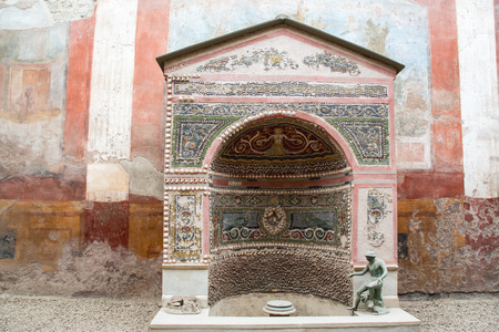 AT POMPEI - ON 0622 2017 -  Decorated fountain in a villa  of  ancient roman town of Pompeii, destroyed by vesuvius eruption in 70 d.c.