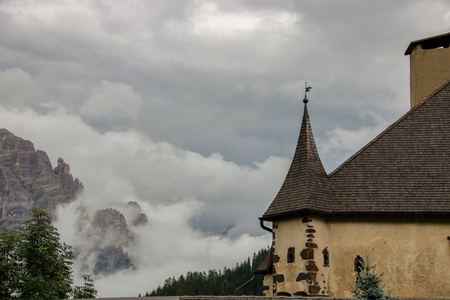 Castle of Villa Badia, covered by clouds and misty in  Alto Adige, Sud Tirol, Italy Stock Photo