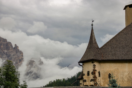 Castle of Villa Badia, covered by clouds and misty in  Alto Adige, Sud Tirol, Italy Editorial