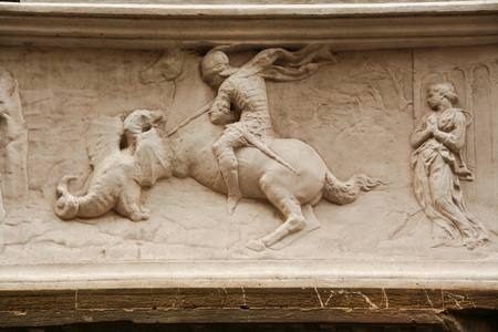 basrelief representing saint george and the dragon by Donatello on the facade of Orsanmichele at Florence, Italy