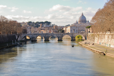View of Tiber, SantAngelo bridge and the dome of San Pietro church
