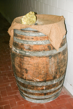 Sulfur rock on a barrel of wine