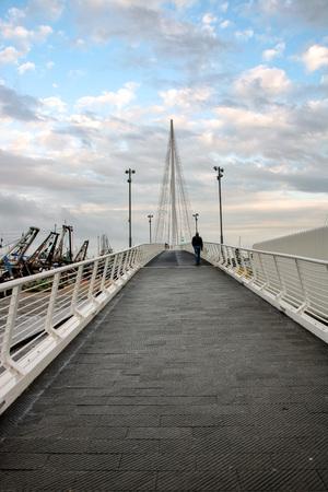 At La Spezia, On 29032018 - the pedestrian  bridge Tahon di revel in the harbor of  La Spezia, Liguria, italy Editöryel