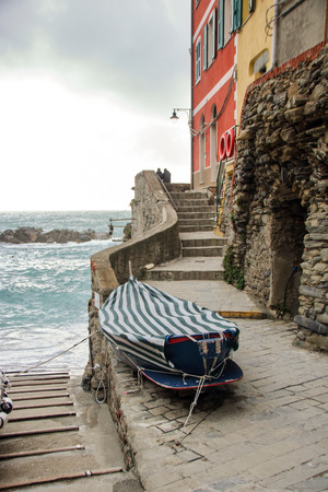 At Riomaggiore, Italy - On mrch, 31, 2018 - The little marina of Riomaggiore, one of the most picturesque village in Cinque Terre in Liguria region, Italy