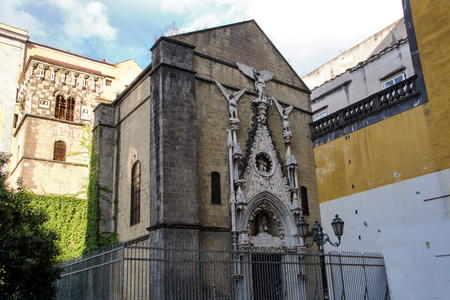 Facade of Pappacoda chapel, monumental church of 15th century with its wonderful doorway in  the original late Gothic style, Naples, Italy 版權商用圖片