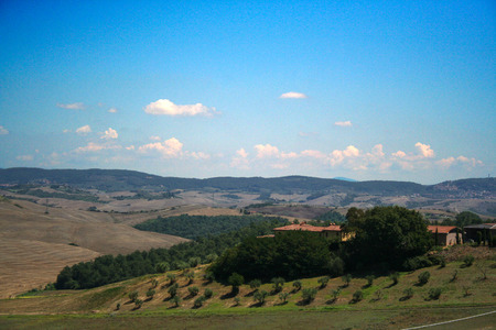 At San Quirico d'Orcia - Italy - Landscape of crete senesi on summer