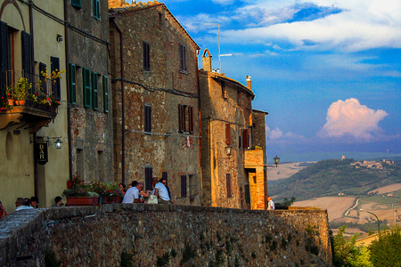 At Pienza, Italy, On august 2011- Tourists having aperitifs on sunset time at Pienza, Italy