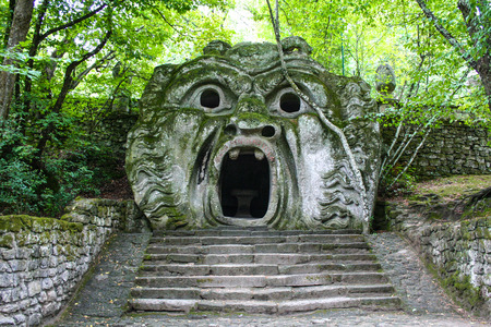 At Bomarzo - Italy - On semptember 2009 - Sacred Grove , known also as Park of the Monsters, populated by grotesque sculptures in manieristic style and small buildings located among the natural vegetation