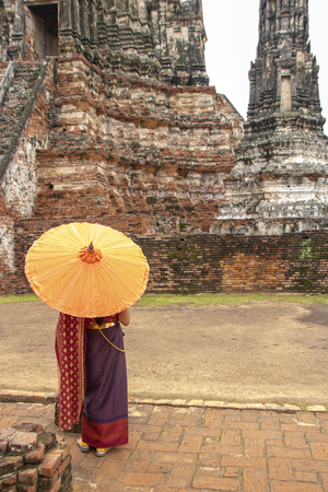 At Ayutthaya - Thailand - On august 2018 -  girl in traditional thai clothes in the Buddhist temple called Wat Chaiwatthanaram