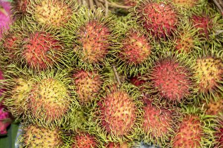 rambutan, typical thai fruit in a market stall Stock Photo