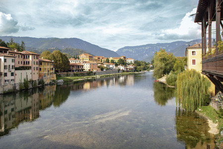landscape of Bassano del Grappa from the old wooden covered bridge on river Brenta  known as alpine bridge, or old bridge,  Veneto, Italy Stok Fotoğraf