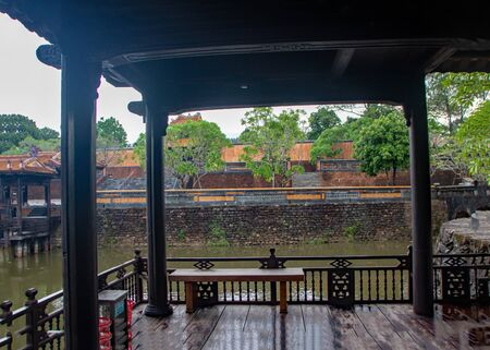 Xung Khiem Pavilion reflecting in Luu Khiem Lake in The Tomb of Tu Duc, at Hue city, Vietnam