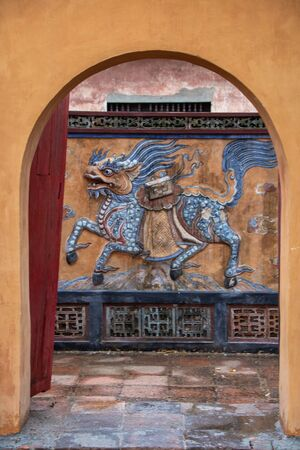Symbol of a dragon on a wall of The Tomb of Tu Duc, at Hue city, Vietnam