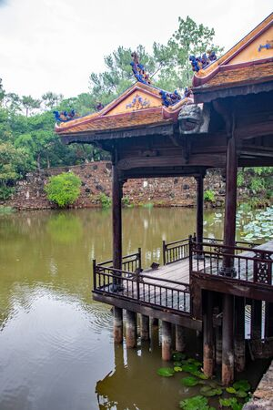 Xung Khiem Pavilion reflecting in Luu Khiem Lake in The Tomb of Tu Duc, at Hue city, Vietnam Stock fotó