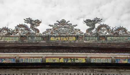Detail of roof decorations with dragon image in the Imperial City (Vietnamese: Hoàng thành), the  walled enclosure within the citadel (Kinh thành) of the city of Huế, the former imperial capital of Vietnam