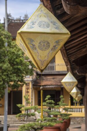 yellow lantern hanging from a pavillion in the  Imperial City,  the  walled enclosure within the citadel (Kinh thành) of the city of Hu?, the former imperial capital of Vietnam 写真素材