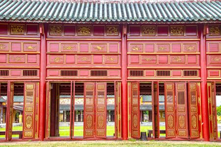 Corridor and red doors in the Forbidden Purple City of The Imperial City (Vietnamese: Hoàng thành), the  walled enclosure within the citadel (Kinh thành) of the city of Huế, the former imperial capital of Vietnam 写真素材