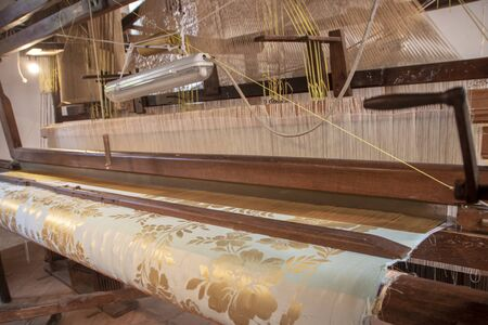 silk Museum with some original old looms and machinery in the real palace of Belvedere San Leucio, Caserta, Italy