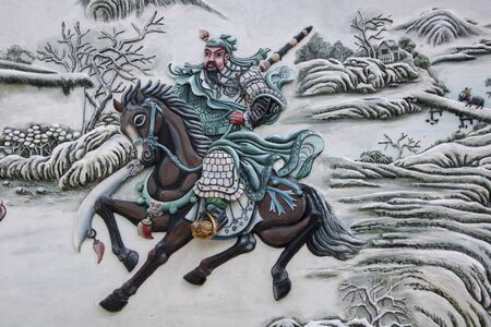 Bas relief representing a knight on a horse  in  the Cantonese Assembly Hall, Quang Trieu, Hoi An Ancient Town, Quang Nam province, South Central Coast, Vietnam 版權商用圖片