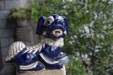 Little ceramic statue of a dog in Fukian Assembly Hall or Phuc Kien in the Hoi An ancient town in Quang Nam Province of Vietnam 版權商用圖片