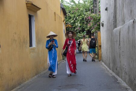 At Hoi An - Vietnam - On august 2019 - girls walking in the street of the old town