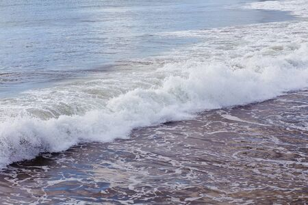 Close up photo of waves rolling in on a beach at Santa Cruz, California, USA