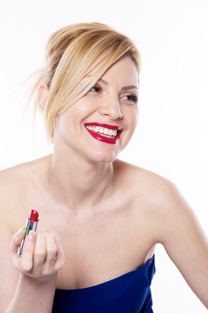 the beautiful blonde woman with lipstick isolated on the white background Stock fotó