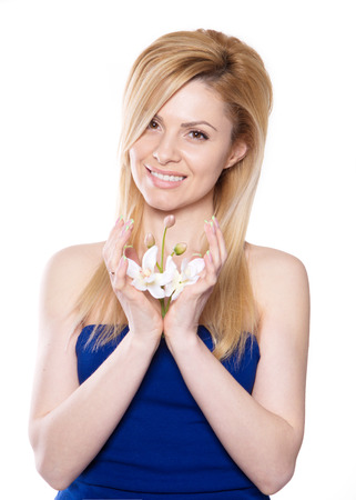 the blonde woman with long hair holding a flower orchid isolated on the white background Stock fotó - 49606562