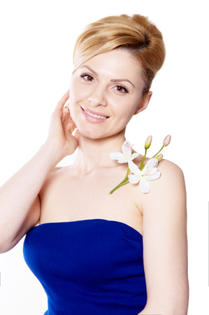 the blonde woman with long hair holding a flower orchid isolated on the white background Stock fotó - 49606620