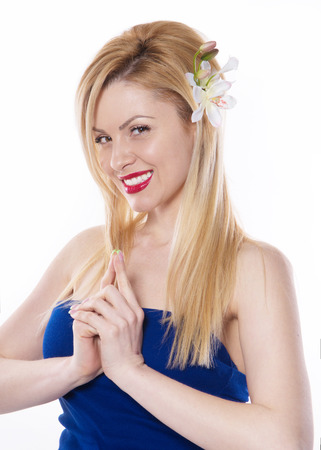 the blonde woman with long hair holding a flower orchid isolated on the white background Stock fotó - 49606622