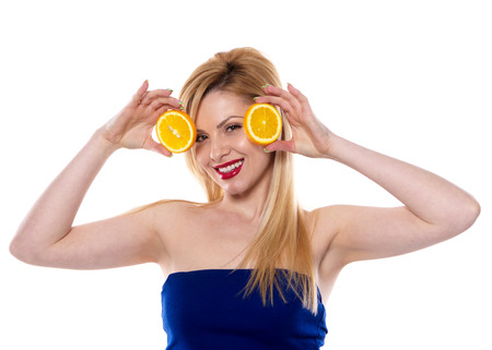 the blond woman with the orange isolated on the white background Stock fotó - 51332289