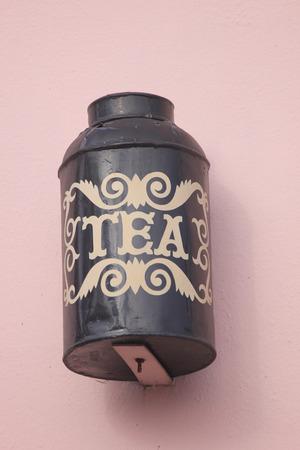 urn: Old-fashioned Tea Urn as Cafe Sign