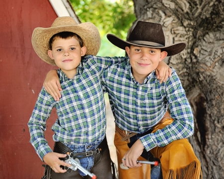 western usa: Young Cowboy Brothers with arms around each other