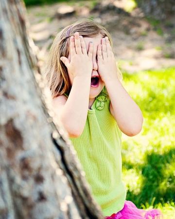 hide and seek: Young Girl playing Hide   Seek