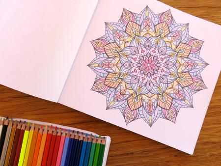 Painting mandalas as a relaxing hobby Stock Photo