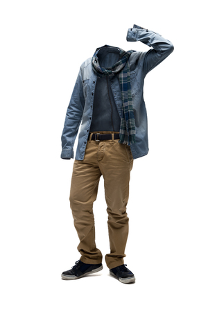 Empty clothes. Checked scarf, denim shirt and brown pants in casual position.