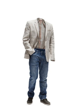 Empty clothes. Beige jacket, worn jeans and green shoes. Imagens - 121195336