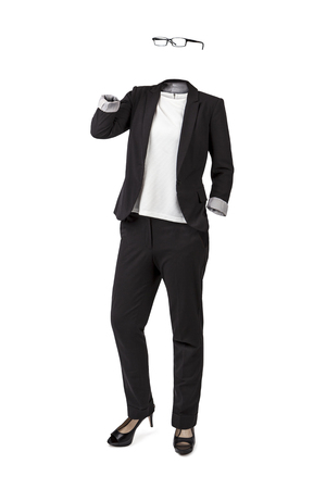 Empty clothes. High woman executive. Black suit, white shirt, glasses and high heels.